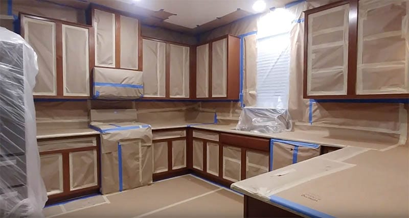 Kitchen Cabinets Masked Off With Paper